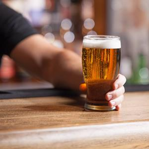 Bartender serving beer: how to start a brewery in Michigan.